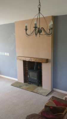 stove installed in fireplace